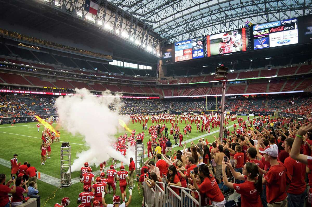 The University of Houston team takes the field to face Southern University in a college football game at Reliant Stadium, Friday, Aug. 30, 2013, in Houston. The Cougars started their season at the home of the Houston Texans because of construction on their new stadium on campus. The team will use three different facilities for their home games in 2013.