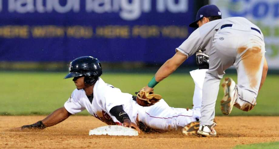 ValleyCats Ronnie Mitchell, left, safely slides under the glove of Vermont Lake Monsters' Chad Pinder during their baseball game on Friday, Aug. 30, 2013, at Bruno Stadium in Troy, N.Y. (Cindy Schultz / Times Union) Photo: Cindy Schultz / 00023639A