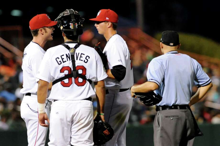 ValleyCats pitching coach Doug White, left, talks with pitcher Troy Scribner, right, and catcher Ernesto Genoves during their baseball game against the Vermont Lake Monsters on Friday, Aug. 30, 2013, at Bruno Stadium in Troy, N.Y. (Cindy Schultz / Times Union) Photo: Cindy Schultz / 00023639A