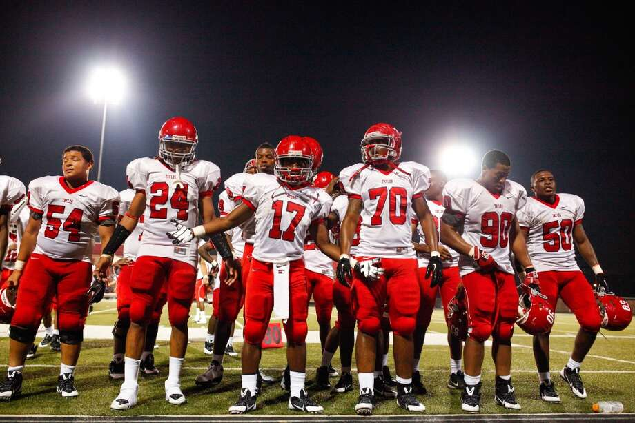 The Alief-Taylor Tigers celebrate following the fourth quarter of a high school football game at Butler stadium on Friday, Aug. 30, 2013, in Houston. ( Andrew Richardson / For the Chronicle )  Alief-Taylor defeated Bellaire 22-9. Photo: For The Chronicle