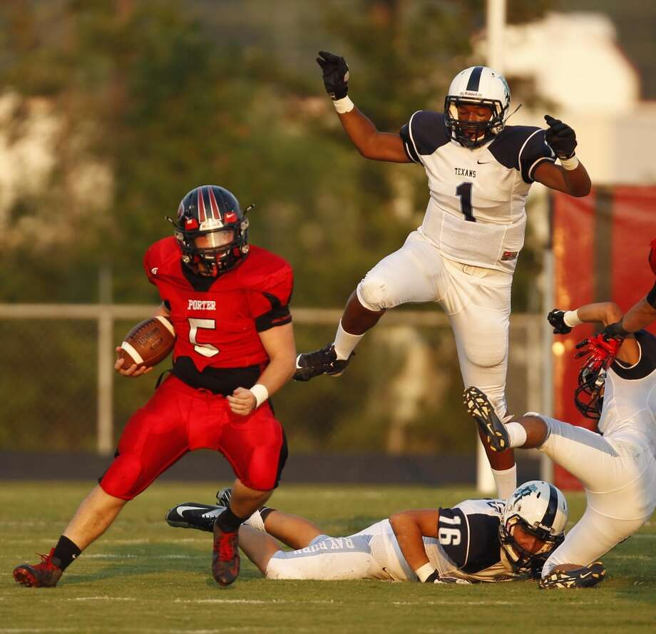 New Caney Porter's Colton Clark (5) runs the ball upfield past Sam Rayburn's Kenneth House (1) during the first half of a high school football game, Friday, August 30, 2013 at Don Ford Stadium in Porter, TX. (Photo: Eric Christian Smith/For the Chronicle) Photo: Eric Christian Smith, For The Chronicle