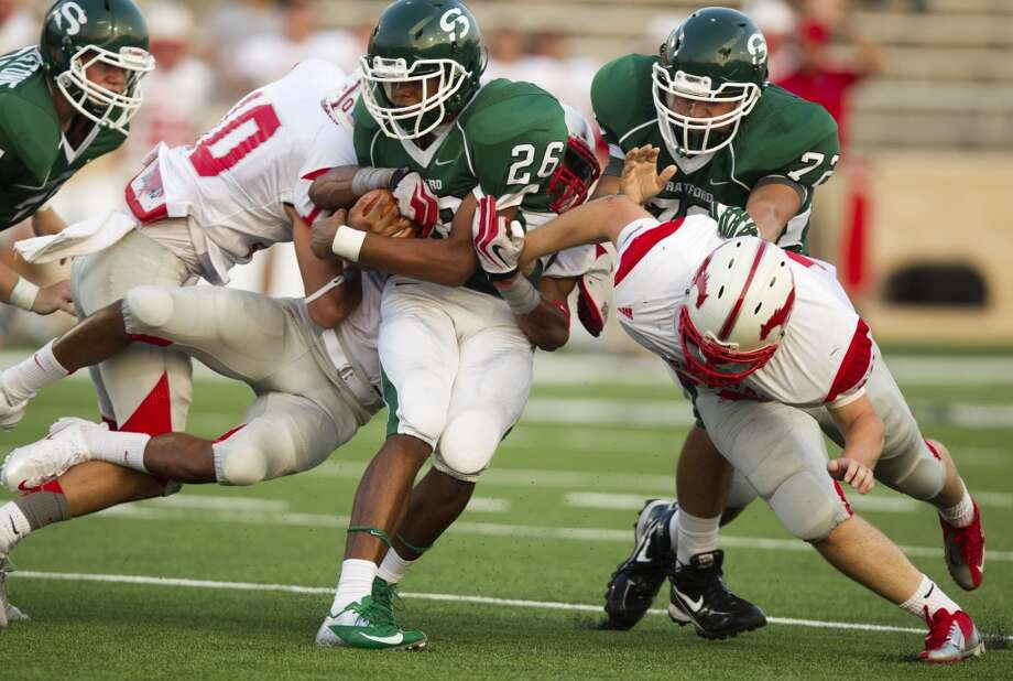 Stratford running back Nick Abreus (26) tries to break through tackles during the first half of a high school football game against Memorial at Tully stadium on Friday, Aug. 30, 2013, in Houston. ( J. Patric Schneider / For the Chronicle ) Photo: J. Patric Schneider, For The Chronicle