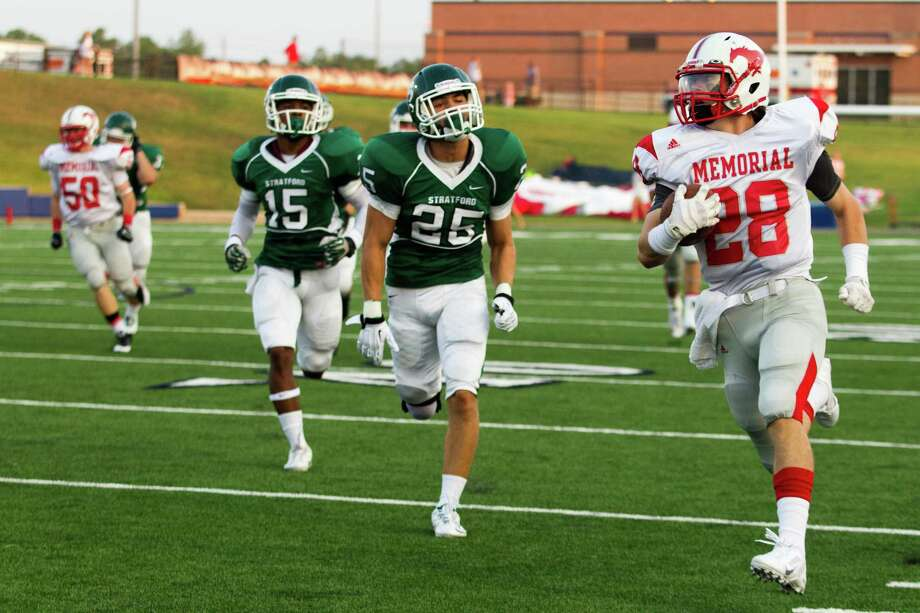 The Stratford defense had no answer for the Memorial rushing attack as running back Matt Collins (28) led the Mustangs with 172 yards and one touchdown. Memorial ran the ball 46 times. Photo: J. Patric Schneider, Freelance / © 2013 Houston Chronicle