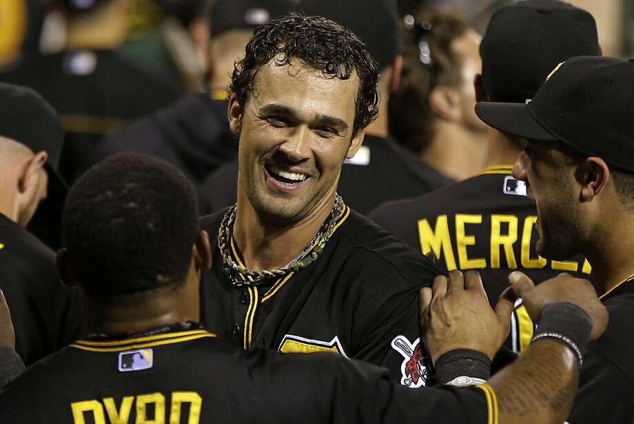Pittsburgh Pirates' Garrett Jones, center, celebrates with teammates after hitting a solo-home run off St. Louis Cardinals starting pitcher Shelby Miller (40) during the fourth inning of a baseball game in  Pittsburgh Friday, Aug. 30, 2013. (AP Photo/Gene J. Puskar) Photo: Gene J. Puskar, Associated Press