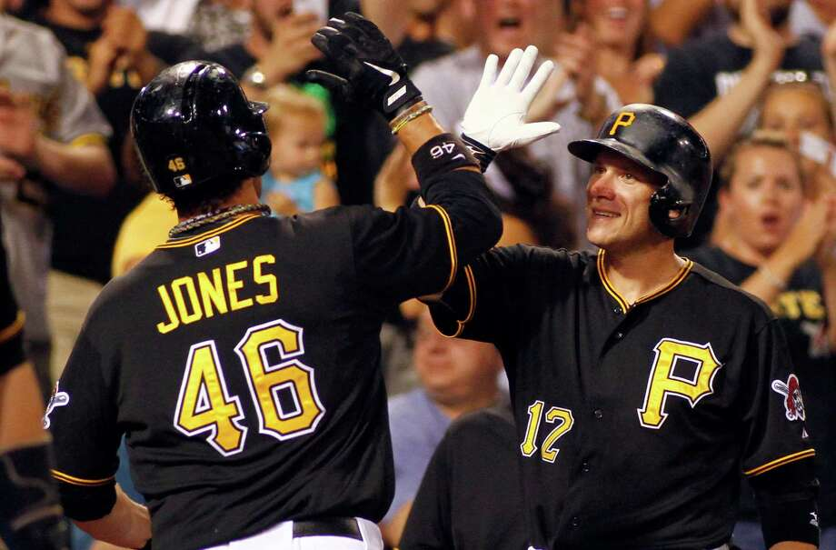 Garrett Jones celebrates with Pirates teammate Clint Barmes (12) after he homered in the fourth inning. Jones finished with four RBIs in a 5-0 win over St. Louis. Photo: Justin K. Aller, Stringer / 2013 Getty Images