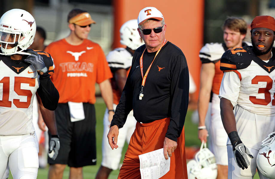 Mack Brown circulates among the players during UT football practice at Denius Fields in Austin  on August 9, 2013. Photo: For The San Antonio Express-News