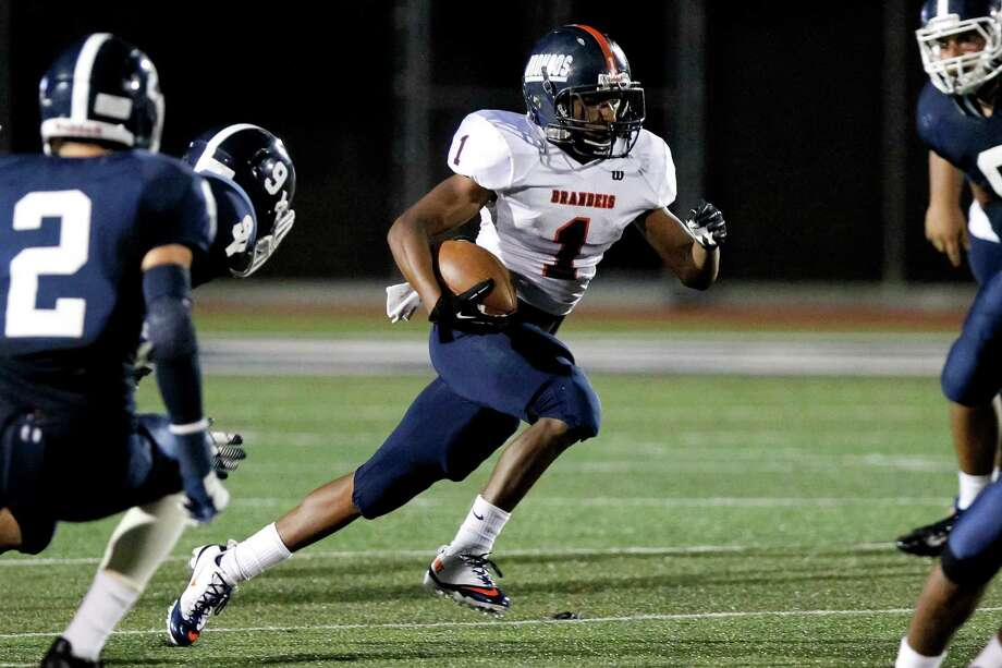Brandeis running back Derek Dennard breaks through the line of scrimmage during the third quarter of  their game with Smithson Valley at Ranger Stadium on Friday, Aug. 30, 2013.  Smithson Valley beat the Broncos 31-12.  MARVIN PFEIFFER/ mpfeiffer@express-news.net Photo: MARVIN PFEIFFER, Marvin Pfeiffer/ Express-News / Express-News 2013