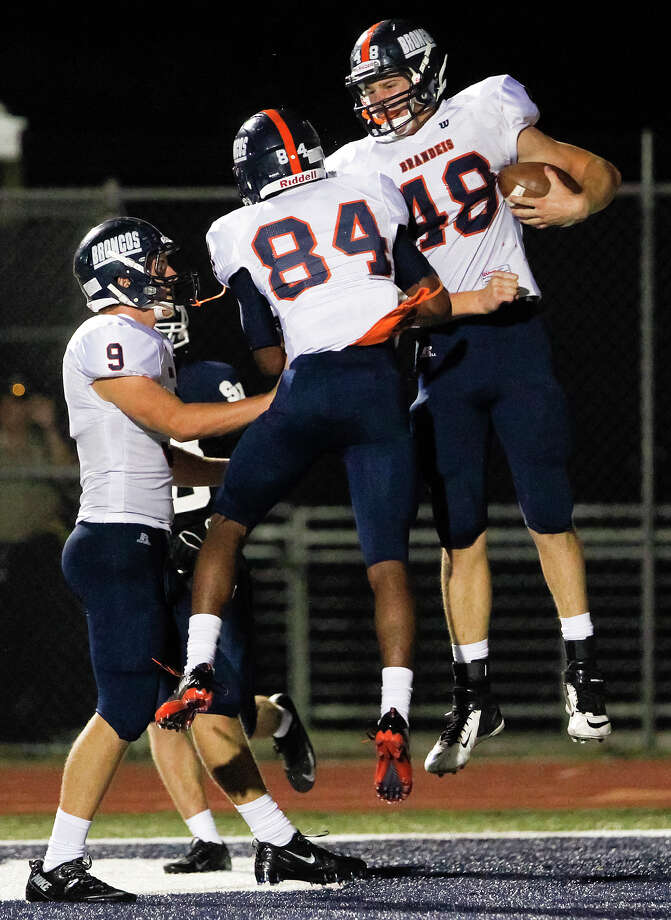Brandeis's Erik Beilman (from right) celebrates his 18-yard touchdown in the third quarter with Larry Stephens and Brandon Smyth during their game with Smithson Valley at Ranger Stadium on Friday, Aug. 30, 2013.  Smithson Valley beat the Broncos 31-12.  MARVIN PFEIFFER/ mpfeiffer@express-news.net Photo: MARVIN PFEIFFER, Marvin Pfeiffer/ Express-News / Express-News 2013