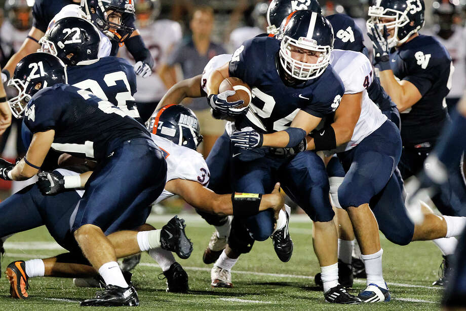 Smithson Valley's Cord Given (center) fights his way through the line of scrimmage during the third quarter of their game with Brandeis at Ranger Stadium on Friday, Aug. 30, 2013.  Smithson Valley beat the Broncos 31-12.  MARVIN PFEIFFER/ mpfeiffer@express-news.net Photo: MARVIN PFEIFFER, Marvin Pfeiffer/ Express-News / Express-News 2013