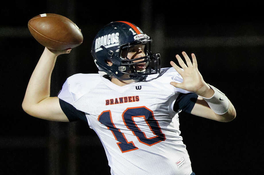 Brandeis quarterback Brian Chapman winds up to throw a pass during the second half of their game with Smithson Valley at Ranger Stadium on Friday, Aug. 30, 2013.  Smithson Valley beat the Broncos 31-12.  MARVIN PFEIFFER/ mpfeiffer@express-news.net Photo: MARVIN PFEIFFER, Marvin Pfeiffer/ Express-News / Express-News 2013