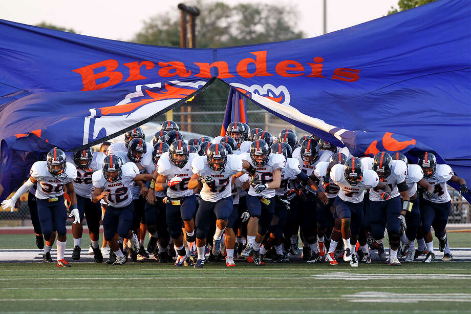 The Brandeis Broncos take the field at the start of their game with Smithson Valley at Ranger Stadium on Friday, Aug. 30, 2013.  MARVIN PFEIFFER/ mpfeiffer@express-news.net Photo: MARVIN PFEIFFER, Marvin Pfeiffer/ Express-News / Express-News 2013