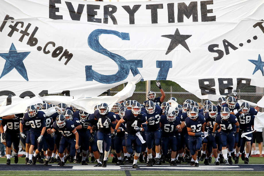 The Smithson Valley Rangers take the field at the start of their game with Brandeis at Ranger Stadium on Friday, Aug. 30, 2013.  MARVIN PFEIFFER/ mpfeiffer@express-news.net Photo: MARVIN PFEIFFER, Marvin Pfeiffer/ Express-News / Express-News 2013