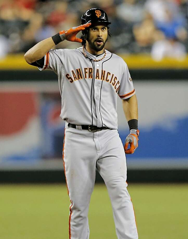San Francisco Giants' Angel Pagan salutes his bench after hitting a leadoff double against the Arizona Diamondbacks during the first inning of a baseball game on Friday, Aug. 30, 2013, in Glendale, Ariz. (AP Photo/Matt York) Photo: Matt York, Associated Press