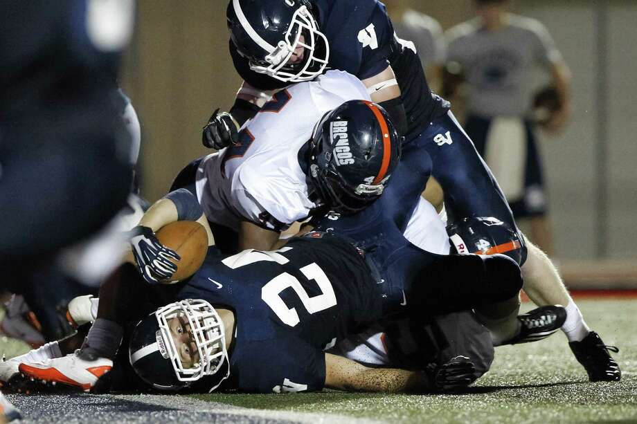Smithson Valley's Cord Given (middle) gets the ball across the goal line for a 1-yard score in the first half.