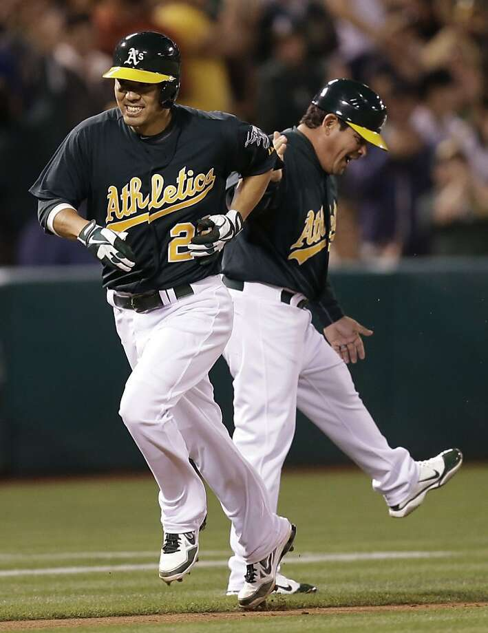 Oakland Athletics' Kurt Suzuki, left, runs the bases past third base coach Mike Gallego after Suzuki hit a three run home run off Tampa Bay Rays' David Price in the fifth inning of a baseball game Friday, Aug. 30, 2013, in Oakland, Calif. (AP Photo/Ben Margot) Photo: Ben Margot, Associated Press