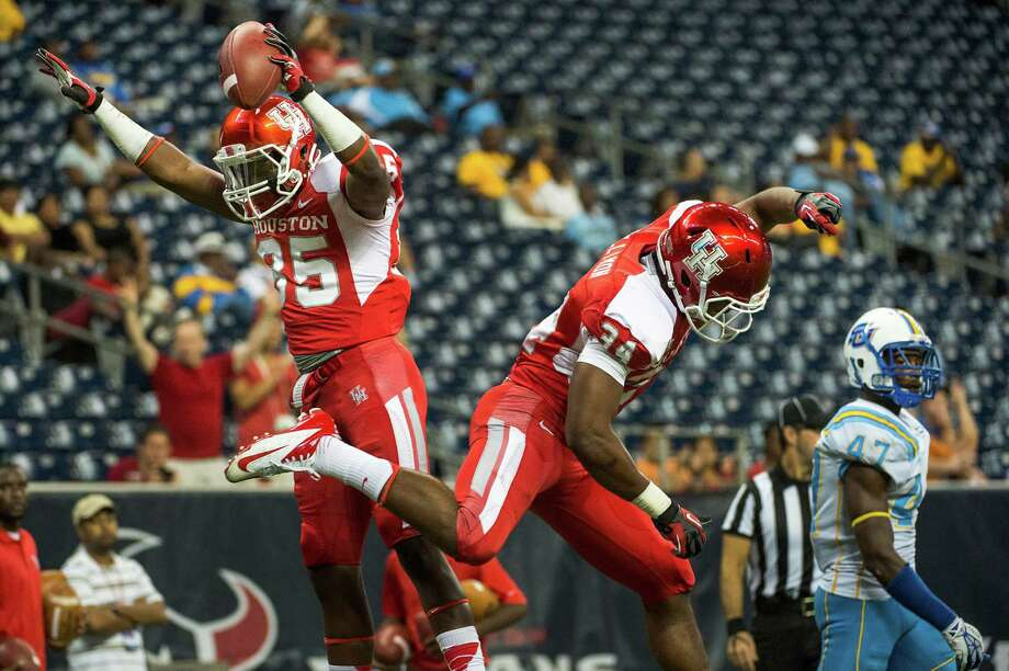 Houston wide receiver John Leday (85) celebrates with running back Randall Hollimon (34) after scoring on a 9-yard touchdown catch for the final score of the game. Photo: Smiley N. Pool, Houston Chronicle / © 2013  Houston Chronicle