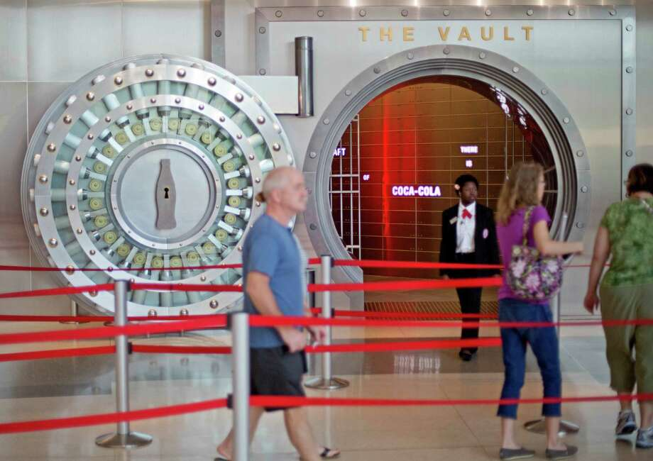 "A tour group enters the vault exhibit containing the ""secret recipe"" for Coke at the World of Coca-Cola museum in Atlanta. Brands like Coke play up the roots of their recipes because it drives billions of dollars in sales. Photo: David Goldman, STF / AP"