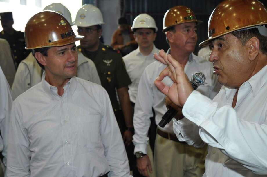 Mexican President Enrique Peña Nieto, left, and Alonso Ancira at the July 18 opening of Altos Hornos' steel plant. Peña Nieto is a member of the Partido Revolucionario Institucional, Ancira's favored political party.