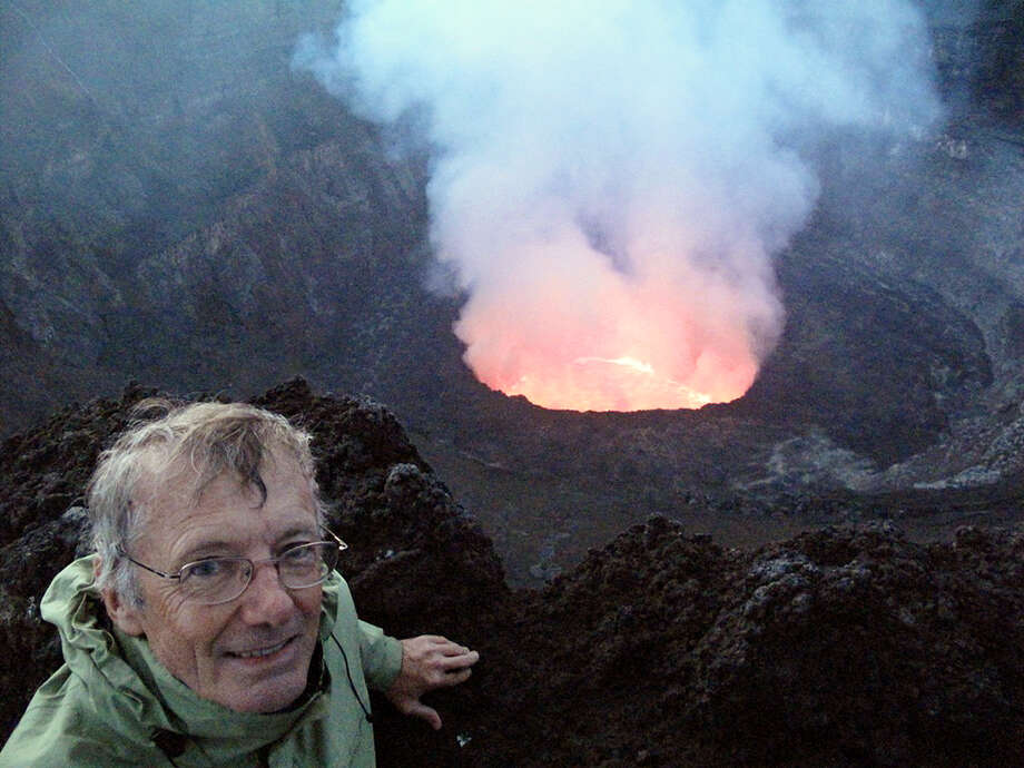 This June 30, 2011, photo shows Tony Wheeler, co-founder of Lonely Planet, at the rim of the very active Nyiragongo Volcano crater near Goma in the Democratic Republic of Congo - one of his favorite places. Photo: HOEP / Lonely Planet
