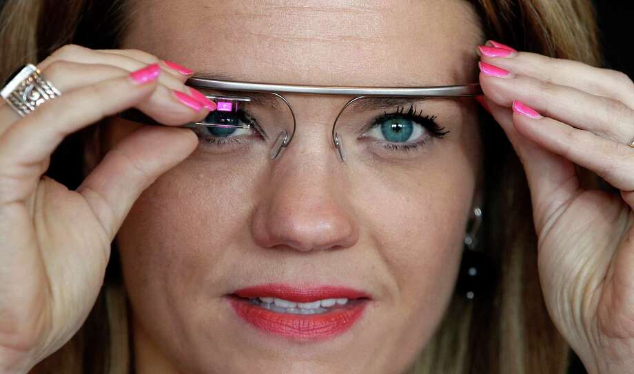 "A Google Glass contest winner, Sarah Hill, of Columbia, Mo., raves about the device. ""This is like having the Internet in your eye socket,"" Hill said. ""But it's less intrusive than I thought it would be."" Photo: Frank Franklin II, STF / AP"