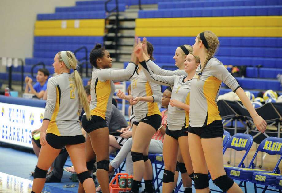 Klein won the match three games to none.   The Klein Oak bench erupts when their team scored a point. Photo: Eddy Matchette, For The Chronicle / Freelance