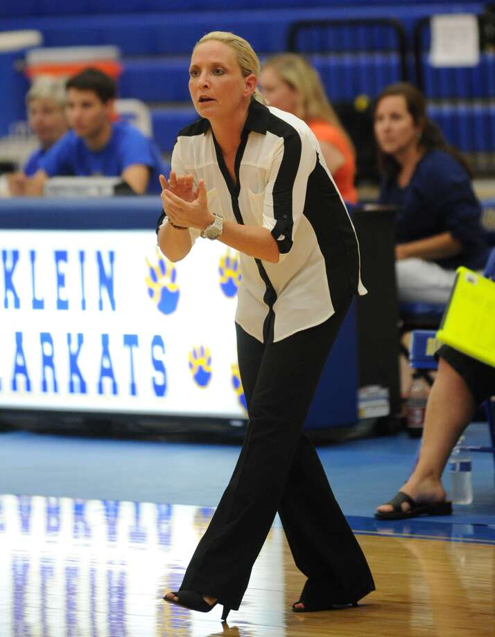 Klein Oak varsity volleyball coach Christie Mewis cheers for her team.. Photo: Eddy Matchette, For The Chronicle / Freelance