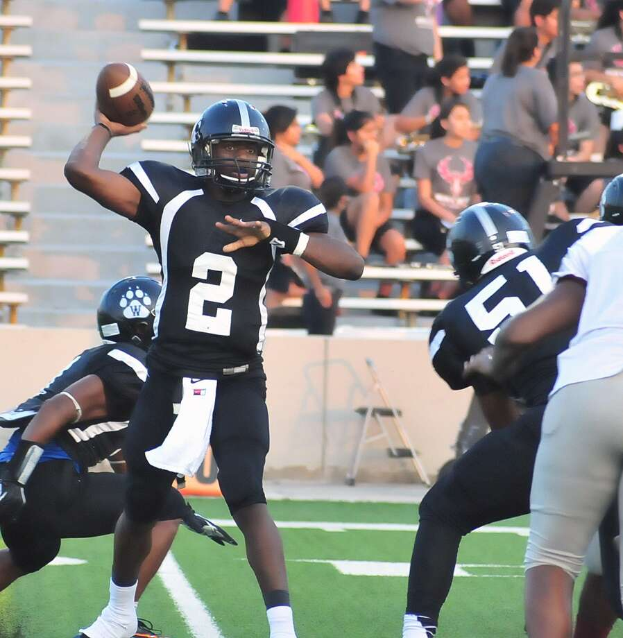 Westside quarterback Michael Haywood (#2) throws from the pocket during their game with Reagan at Delmar Stadium Friday, Aug. 30. Photo: © Tony Bullard 2013, Tony Bullard / © Tony Bullard & the Houston Chronicle