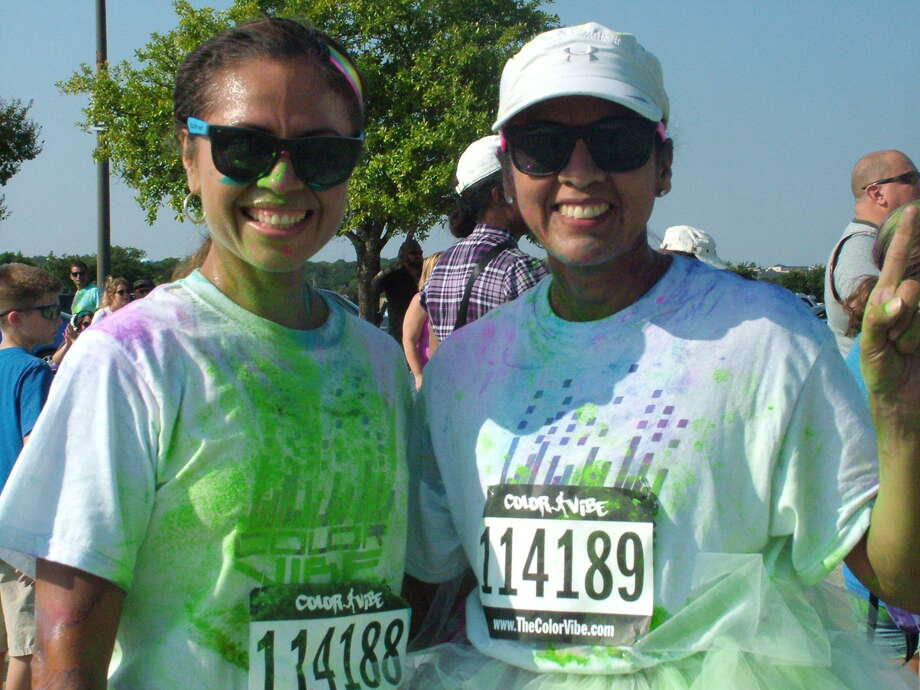 Participants in the Color Vibe 5K finish their run with a dance Party Saturday at Retama Park. Photo: Pam Howell