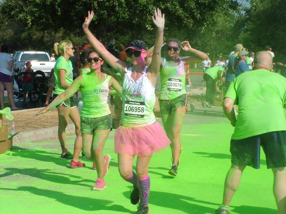 Participants in the Color Vibe 5K finish their run with a dance Party Saturday at Retama Park.Click here for more information Photo: Pam Howell