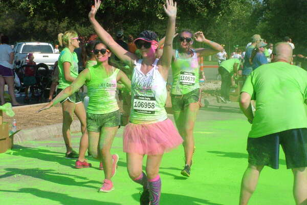 Participants in the Color Vibe 5K finish their run with a dance Party Saturday at Retama Park.