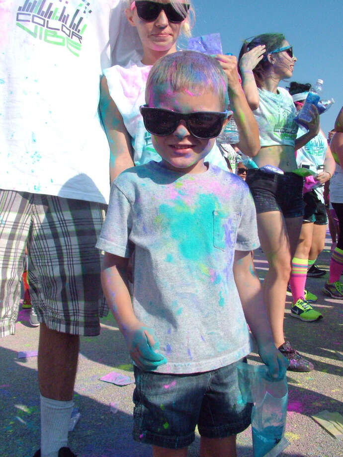 Participants in the Color Vibe 5k ended their run Saturday at Retama Park with a dance party. Photo: Pam Howell