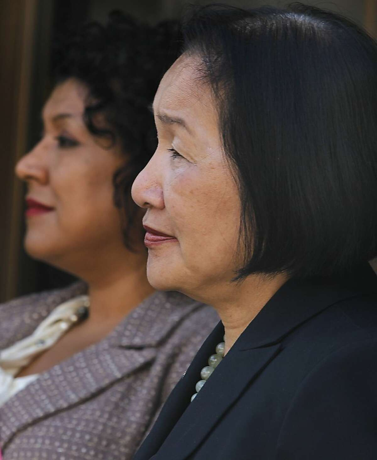 Oakland mayor Jean Quan appears at a news conference with city administrator Deanna Santana (left) to tout downtown Oakland's revitalization at a news conference on the steps of City Hall in Oakland, Calif. on Wednesday, Oct. 24, 2012. Thursday marks the one-year anniversary of the Occupy Oakland movement.