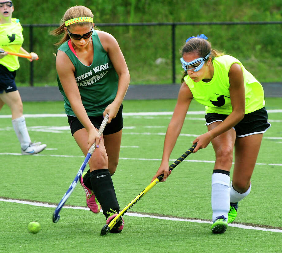 Meg Lacey, left, struggles to keep the ball from Katie Allen, as New Milford plays Immaculate in the Immaculate High field hockey jamboree, at Immaculate High School, in Danbury, Conn. Saturday, Aug. 30, 2013. Photo: Michael Duffy / The News-Times
