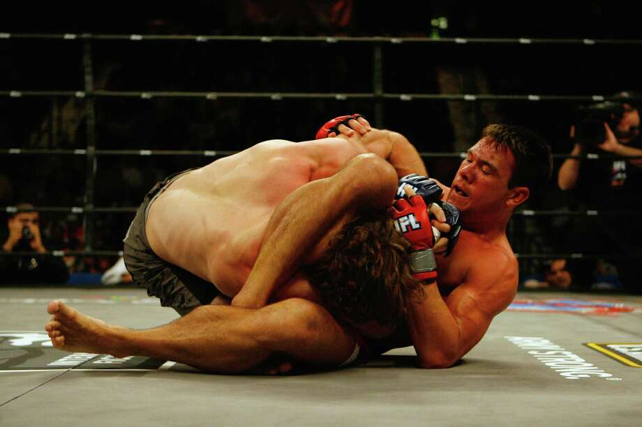 UNCASVILLE, CT - DECEMBER 29:  Brett Cooper (Black Trunks) attempts a submission hold on Rory Markham (Red Trunks) during their Welterweight bout presented by the International Fighting League World Grand Prix at the Mohegan Sun Arena December 29, 2007 in Uncasville, Connecticut. Photo: Jim Rogash / 2007 Getty Images