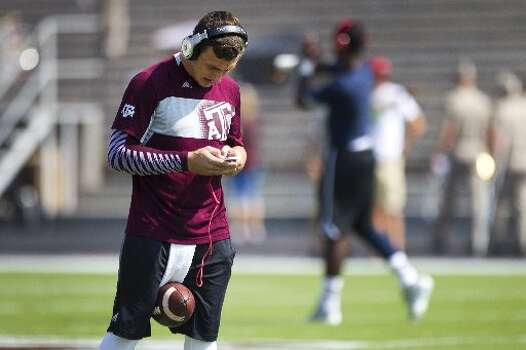 Texas A&M quarterback Johnny Manziel warms up before facing Rice. Photo: Brett Coomer, Houston Chronicle