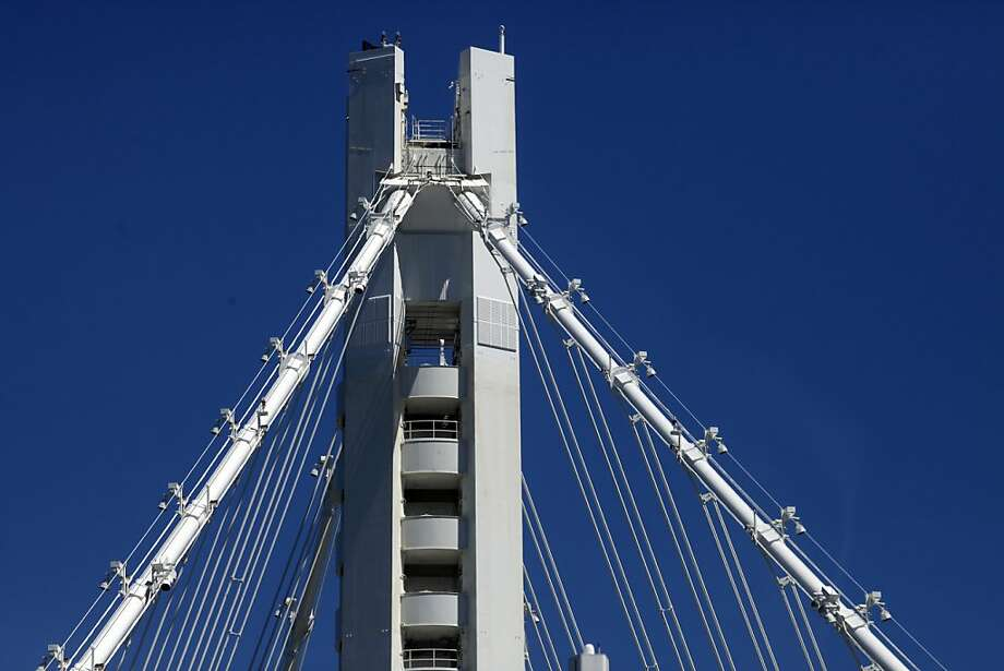 The sunlight beats on the tower of the new span of the Bay Bridge, Friday August 30, 2013,  in Oakland, Calif. Photo: Lacy Atkins, The Chronicle