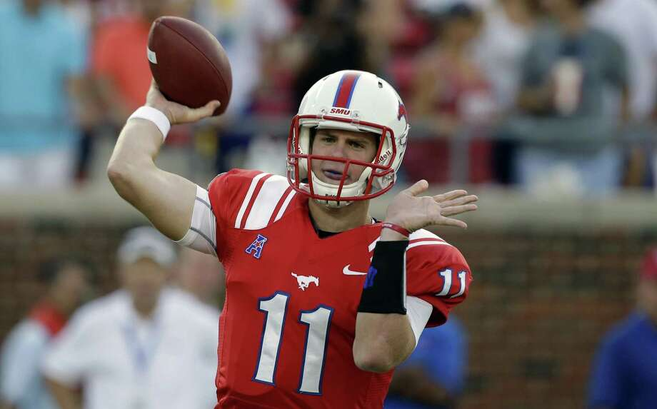 Southern Methodist quarterback Garrett Gilbert (11) passes during the first half of an NCAA college football game against Texas Tech, Friday, Aug. 30, 2013, in Dallas. (AP Photo/LM Otero) Photo: LM Otero, STF / AP