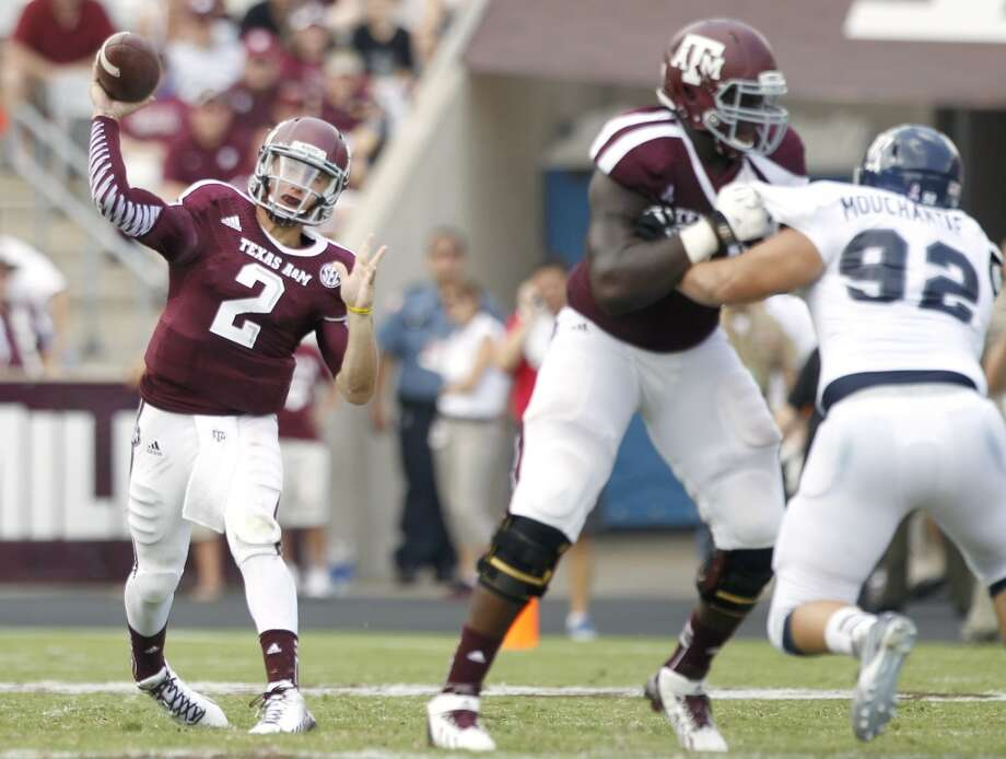 Texas A&M quarterback Johnny Manziel throws a pass against Rice during the fourth quarter of an NCAA college football game at Kyle Field Saturday, Aug. 31, 2013, in College Station. ( Brett Coomer / Houston Chronicle ) Photo: Brett Coomer, Houston Chronicle