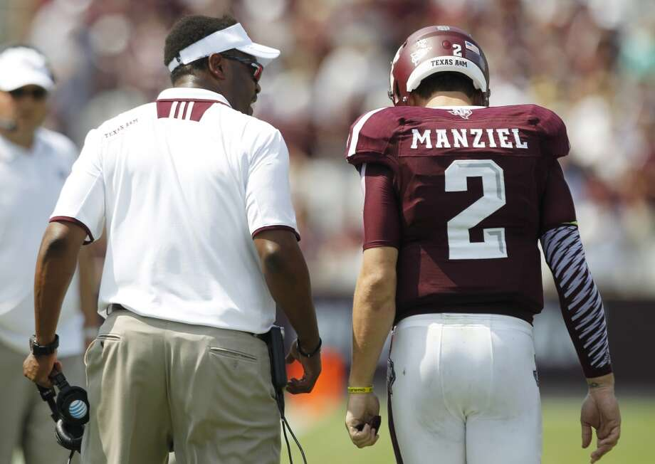 Texas A&M head coach Kevin Sumlin, left, talks to  quarterback Johnny Manziel (2) after Manziel was penalized for unsportsmanlike conduct during the fourth quarter of an NCAA college football game against Rice at Kyle Field Saturday, Aug. 31, 2013, in College Station. ( Brett Coomer / Houston Chronicle ) Photo: Brett Coomer, Houston Chronicle
