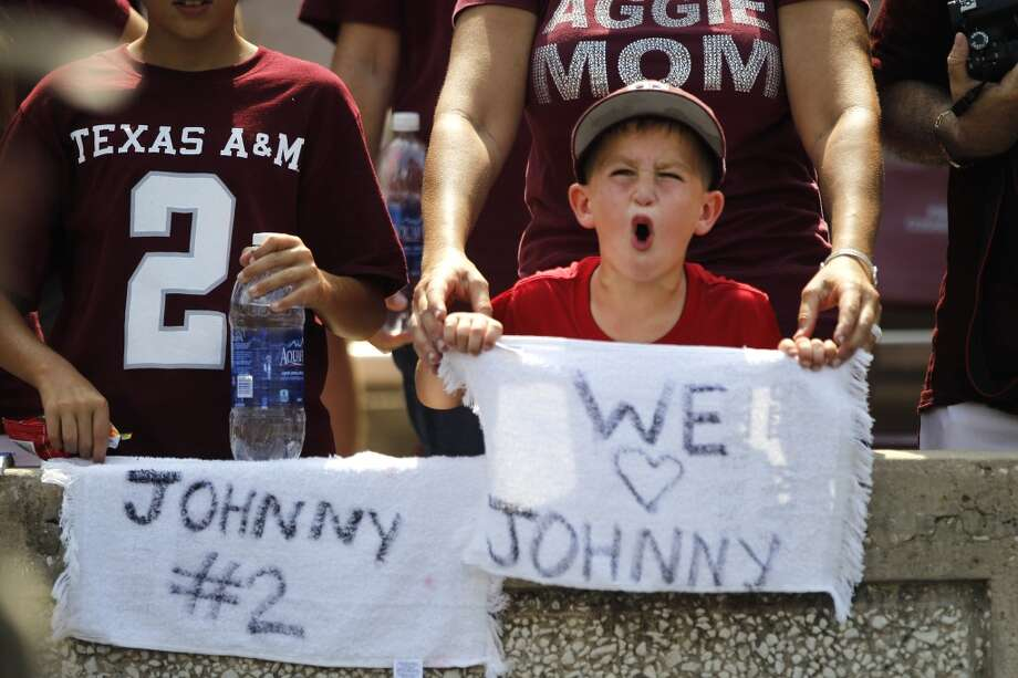 Texas A&M fan Reese Atterberry cheers during the fourth quarter of an NCAA college football game against Rice at Kyle Field Saturday, Aug. 31, 2013, in College Station. ( Brett Coomer / Houston Chronicle ) Photo: Brett Coomer, Houston Chronicle