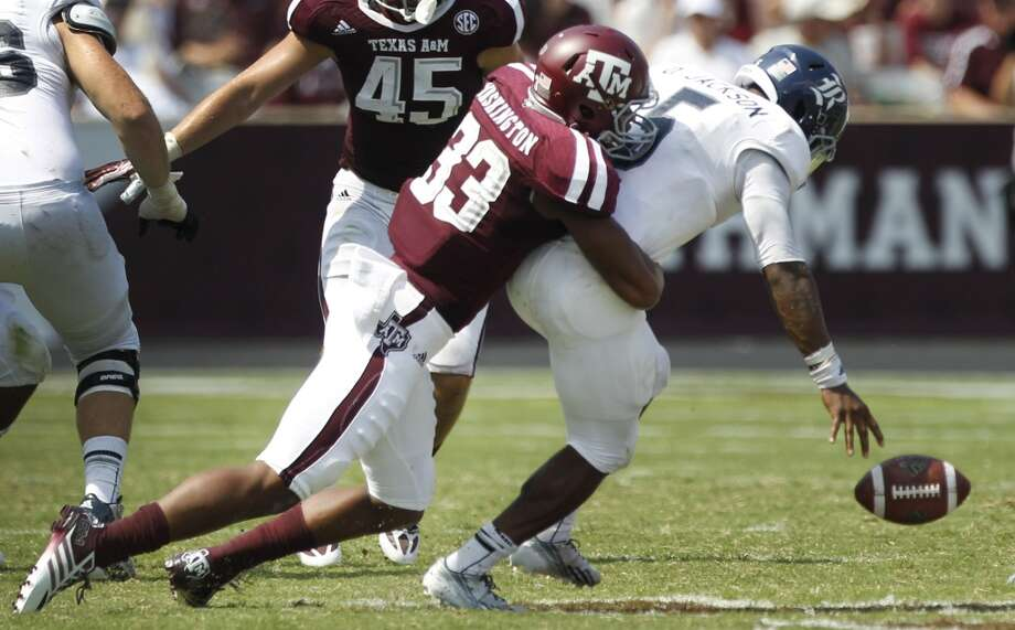 Texas A&M linebacker Shaan Washington (33) forces a fumble by Rice quarterback Driphus Jackson (5) during the fourth quarter of an NCAA college football game at Kyle Field Saturday, Aug. 31, 2013, in College Station. ( Brett Coomer / Houston Chronicle ) Photo: Brett Coomer, Houston Chronicle