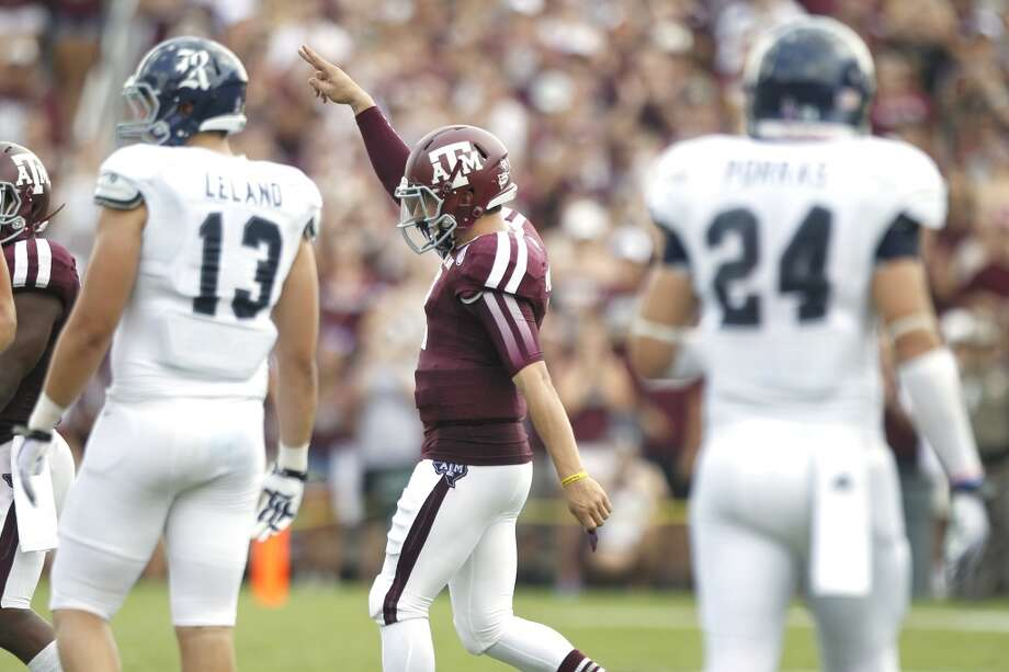 Texas A&M quarterback Johnny Manziel (2) gestures to the Aggies fans as he walks onto the field after serving a half-game suspension against Rice during the third quarter of an NCAA college football game at Kyle Field Saturday, Aug. 31, 2013, in College Station. ( Brett Coomer / Houston Chronicle ) Photo: Brett Coomer, Houston Chronicle