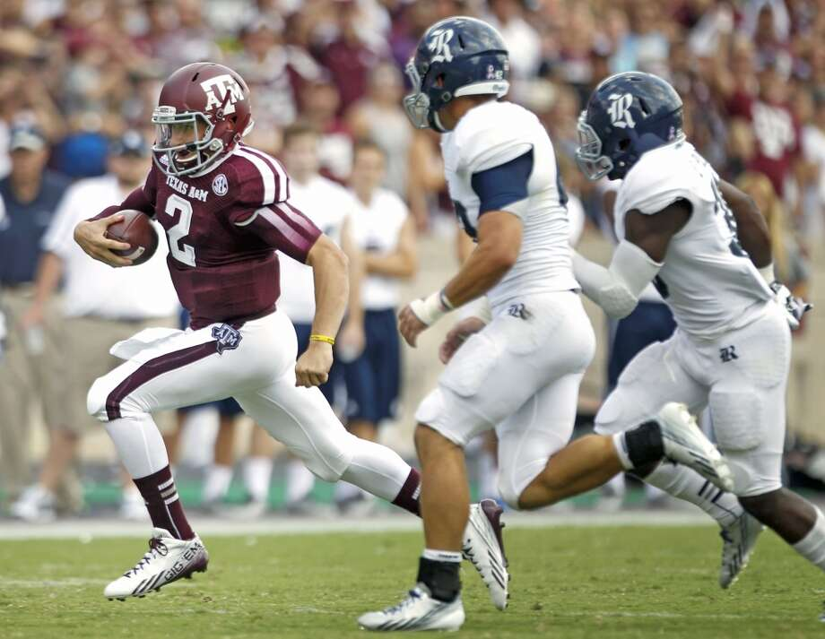 Texas A&M quarterback Johnny Manziel (2) is chased by Rice linebacker Michael Kutzler (42) and cornerback Darrion Pollard (38) during the third quarter of an NCAA college football game at Kyle Field Saturday, Aug. 31, 2013, in College Station. ( Brett Coomer / Houston Chronicle ) Photo: Brett Coomer, Houston Chronicle