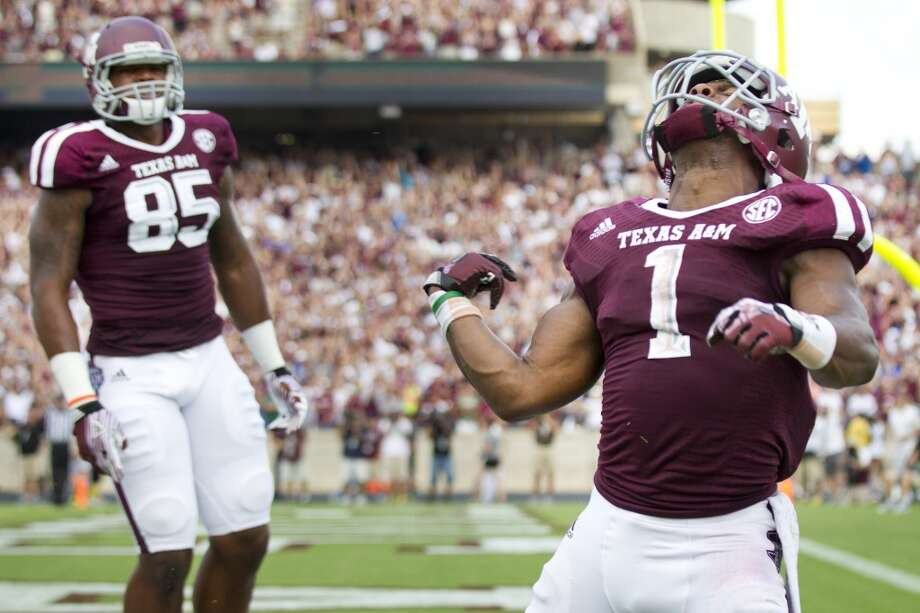Texas A&M running back Ben Malena (1) celebrates his 18-yard touchdown reception against Rice during the fourth quarter of an NCAA college football game at Kyle Field Saturday, Aug. 31, 2013, in College Station. ( Brett Coomer / Houston Chronicle ) Photo: Brett Coomer, Houston Chronicle