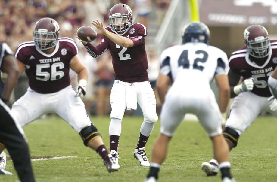 Texas A&M quarterback Johnny Manziel (2) takes his first snap from center Mike Matthews (56) during the third quarter of an NCAA college football game against Rice at Kyle Field Saturday, Aug. 31, 2013, in College Station. ( Brett Coomer / Houston Chronicle ) Photo: Brett Coomer, Houston Chronicle