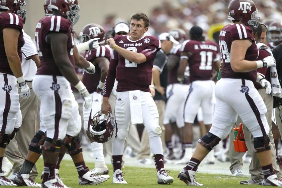 Texas A&M quarterback Johnny Manziel (2) congratulates his teammates after an A&M score during the third quarter of an NCAA college football game against Rice at Kyle Field Saturday, Aug. 31, 2013, in College Station. ( Brett Coomer / Houston Chronicle ) Photo: Brett Coomer, Houston Chronicle