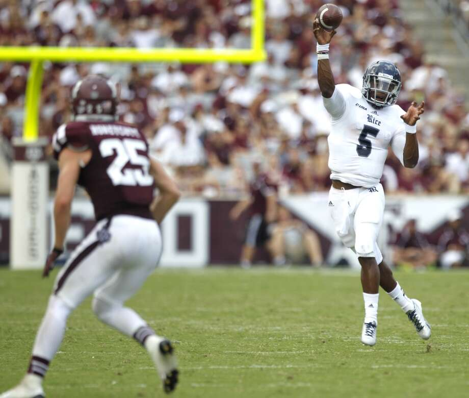 Rice quarterback Driphus Jackson (5) passes the football with Texas A&M defensive back Clay Honeycutt (25) defending during the third quarter of an NCAA college football game at Kyle Field Saturday, Aug. 31, 2013, in College Station. ( Brett Coomer / Houston Chronicle ) Photo: Brett Coomer, Houston Chronicle