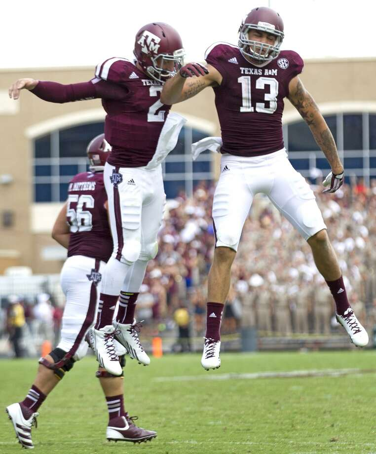 Texas A&M quarterback Johnny Manziel (2) and wide receiver Mike Evans (13) celebrate Evans' 23-yard touchdown reception against Rice during the third quarter of an NCAA college football game at Kyle Field Saturday, Aug. 31, 2013, in College Station. ( Brett Coomer / Houston Chronicle ) Photo: Brett Coomer, Houston Chronicle