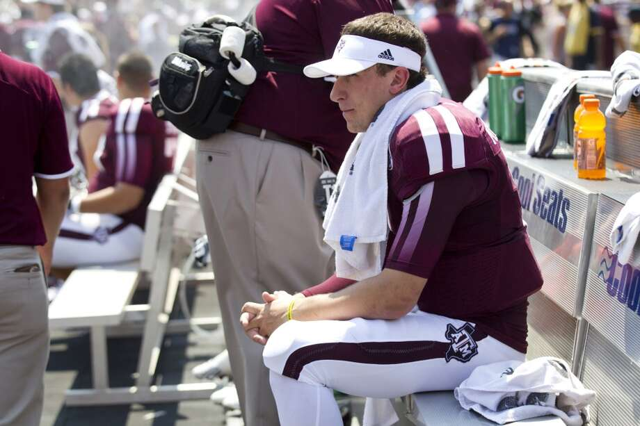 Texas A&M quarterback Johnny Manziel (2) sits on the bench during the first quarter of an NCAA college football game against Rice at Kyle Field Saturday, Aug. 31, 2013, in College Station. ( Brett Coomer / Houston Chronicle ) Photo: Brett Coomer, Houston Chronicle