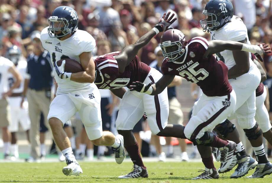 Rice quarterback Taylor McHargue (16) runs past Texas A&M linebackers Tyrone Taylor (50) and Tyrell Taylor (35) during the first quarter of an NCAA college football game at Kyle Field Saturday, Aug. 31, 2013, in College Station. ( Brett Coomer / Houston Chronicle ) Photo: Brett Coomer, Houston Chronicle